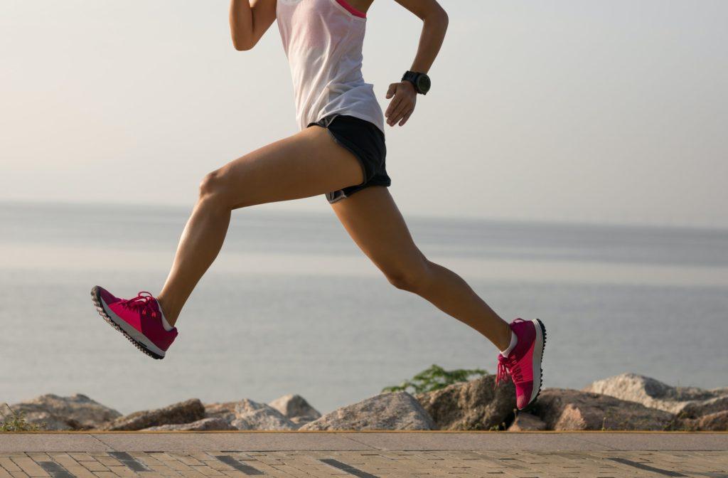 woman running on seaside